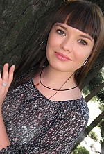 Ukrainian girl Irina,33 years old with green eyes and black hair.