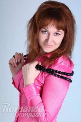 Ukrainian girl Anzhela,50 years old with grey eyes and red hair.