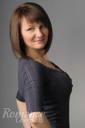 Ukrainian girl Angelika,46 years old with green eyes and light brown hair.