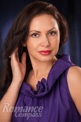 Ukrainian girl Irina,46 years old with blue eyes and dark brown hair.