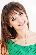 Ukrainian girl Angela,40 years old with brown eyes and dark brown hair.