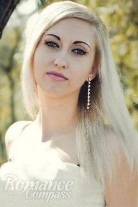 Ukrainian girl Viktoriya,26 years old with green eyes and blonde hair.