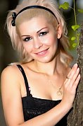 Ukrainian girl Yulia,37 years old with blue eyes and blonde hair.