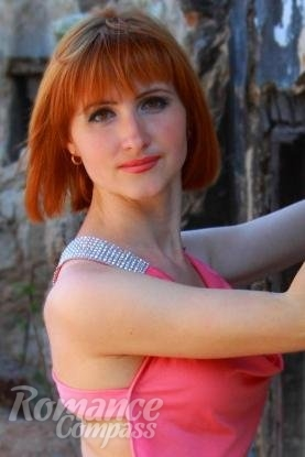 Ukrainian girl Aliona,33 years old with hazel eyes and red hair.