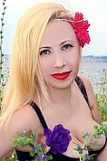 Ukrainian girl Olga,31 years old with blue eyes and blonde hair.