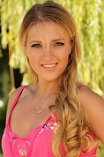 Ukrainian girl Natalia,31 years old with grey eyes and blonde hair.