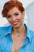Ukrainian girl Svetlana,27 years old with brown eyes and red hair.