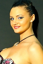 Ukrainian girl Maria,27 years old with blue eyes and black hair.