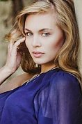 Russian girl Anastasia,24 years old with blue eyes and blonde hair.