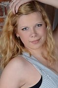 Ukrainian girl Tatyana,21 years old with brown eyes and red hair.