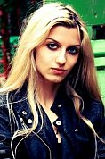 Russian girl Nino,24 years old with green eyes and blonde hair.
