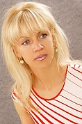 Ukrainian girl Natalia,54 years old with blue eyes and blonde hair.