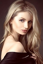 Ukrainian girl Natali,36 years old with blue eyes and blonde hair.