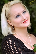 Ukrainian girl Alla,47 years old with blue eyes and blonde hair.