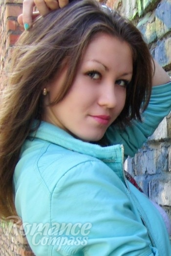 Ukrainian girl Nadezhda,21 years old with green eyes and dark brown hair.