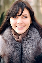 Ukrainian girl Anastasiya,28 years old with blue eyes and black hair.