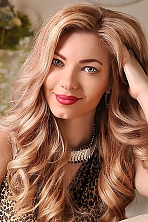 Ukrainian girl Elena,30 years old with green eyes and light brown hair.
