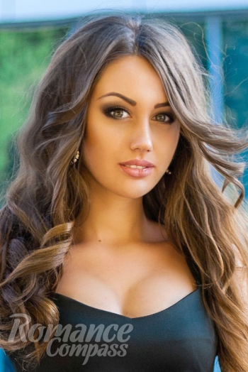 Ukrainian girl Daria,23 years old with green eyes and dark brown hair.