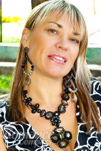 Ukrainian girl Marina,44 years old with grey eyes and light brown hair.