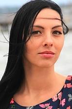 Ukrainian girl Marina,27 years old with brown eyes and dark brown hair.