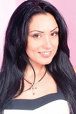 Ukrainian girl Polina,34 years old with brown eyes and black hair.