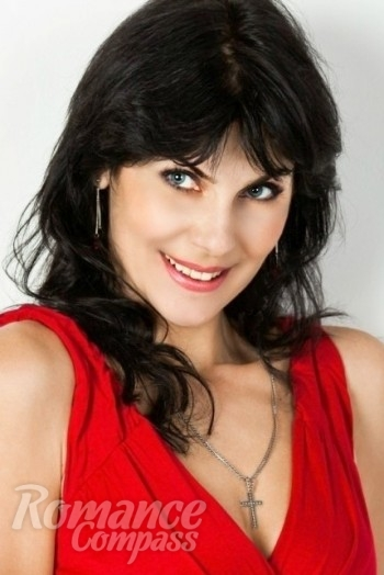 Ukrainian girl Alena,43 years old with blue eyes and black hair.