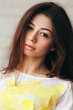 Ukrainian girl Alexandra,22 years old with grey eyes and light brown hair.