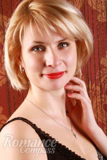 Ukrainian girl Oksana,34 years old with grey eyes and blonde hair.