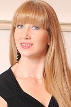 Ukrainian girl Nadejda,38 years old with blue eyes and blonde hair.