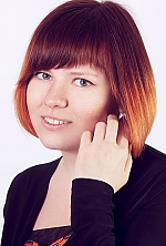 Ukrainian girl Inna,20 years old with grey eyes and red hair.