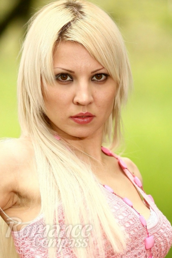 Ukrainian girl Maria,32 years old with brown eyes and blonde hair.