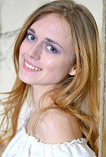 Ukrainian girl Anna,24 years old with green eyes and light brown hair.