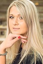 Ukrainian girl Svetlana,29 years old with green eyes and blonde hair.