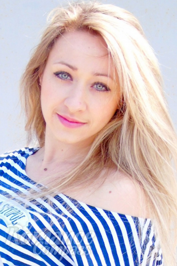 Ukrainian girl Marina,27 years old with green eyes and blonde hair.