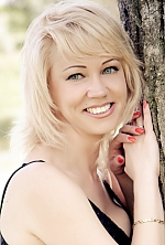 Ukrainian girl Vita,40 years old with blue eyes and blonde hair.