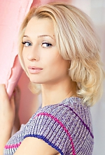 Ukrainian girl Tatiana,28 years old with blue eyes and blonde hair.