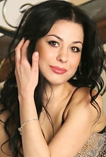 Ukrainian girl Nadejda,32 years old with brown eyes and black hair.