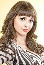 Ukrainian girl Oksana,23 years old with green eyes and dark brown hair.