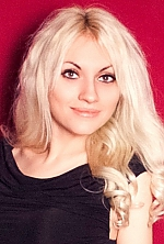 Ukrainian girl Ol'ga,21 years old with green eyes and blonde hair.