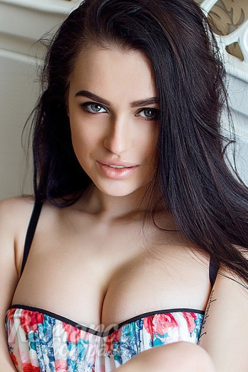 Ukrainian girl Lubov,27 years old with green eyes and black hair.