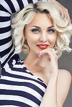 Ukrainian girl Maria,26 years old with blue eyes and blonde hair.