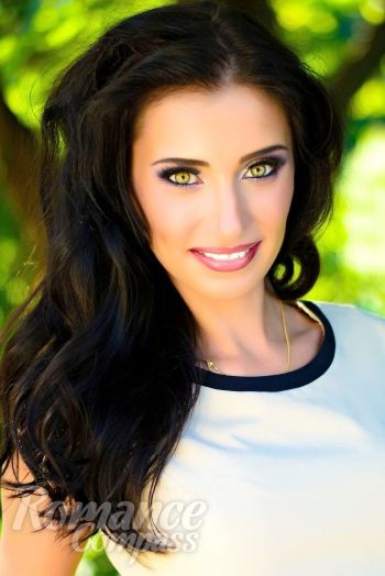 Ukrainian girl Tatiana,30 years old with green eyes and black hair.
