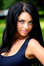 Ukrainian girl Olesya,29 years old with blue eyes and black hair.