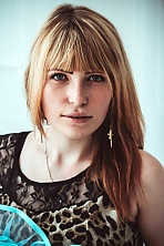 Ukrainian girl Alexandra,21 years old with green eyes and blonde hair.