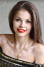 Ukrainian girl Alesia,26 years old with green eyes and dark brown hair.