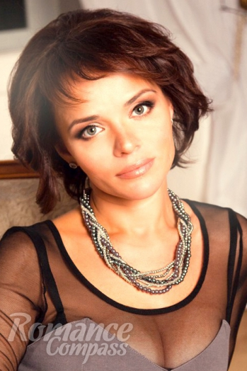 Russian girl Ludmila,41 years old with grey eyes and dark brown hair.