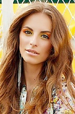 Ukrainian girl  Yana,24 years old with brown eyes and light brown hair.