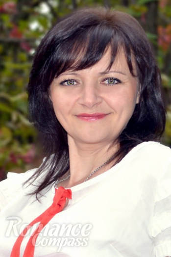 Ukrainian girl Viktoria,44 years old with grey eyes and black hair.