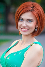 Ukrainian girl Alena,37 years old with blue eyes and red hair.