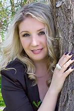 Ukrainian girl Snezhana,41 years old with brown eyes and blonde hair.